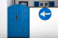 Wooden entrance door in blue with traff