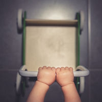 Baby pushing his  or her walker