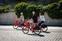 Three young men riding ebikes or. electric bikes of   bicycle sharing service  JUMP by UBER