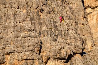 Vertical walls with climber Cinque Torri