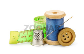 Thread, needle, button, measuring tape and thimble