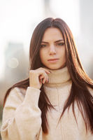 Young girl in autumn sweater