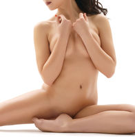 Sexy brunette sits in a gracefull split naked