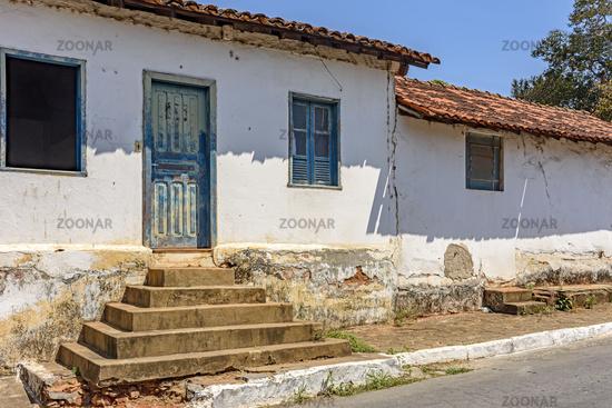 Old weathered house with potholed walls