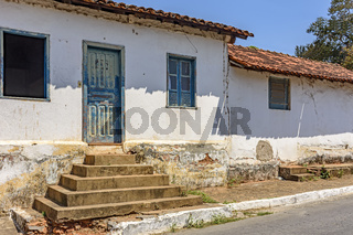 Old weathered house with potholed walls