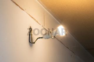 Light bulb hanging on a wall