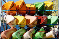 Colourful sea kayaks on Wellington sea front, New Zealand.