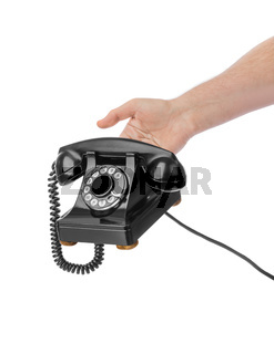 Hand and vintage telephone