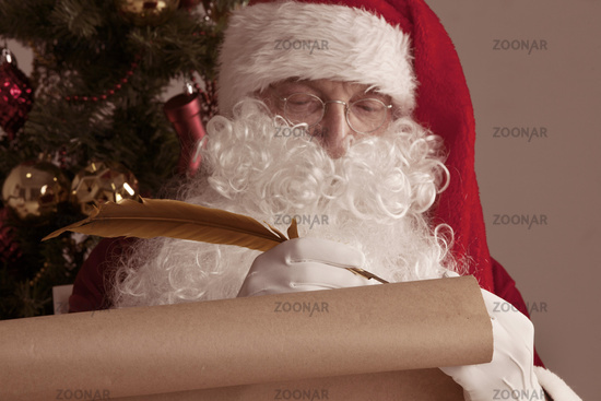 Santa Claus writing on old paper