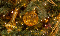 Christmas tree with silver bauble ornaments. Decorated Christmas tree closeup. Balls and illuminated garland with flashlights. New Year baubles macro photo with bokeh. Winter holiday light decoration