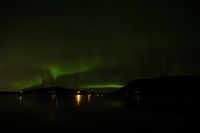 Northern light in Hafravatn lake, Iceland