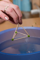 three-sided pyramid in physics experiment with sheath surrounded - closeup