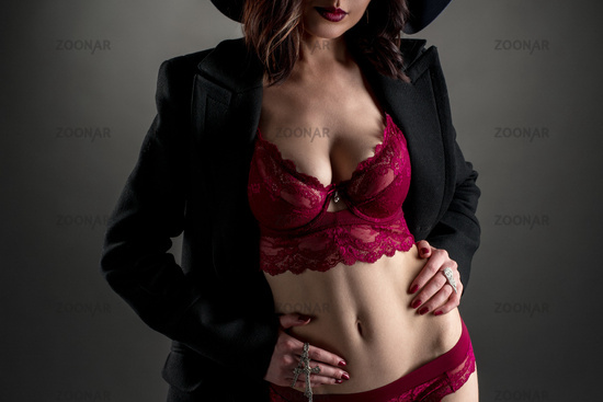 Stylishly dressed woman showing her sexy lingerie