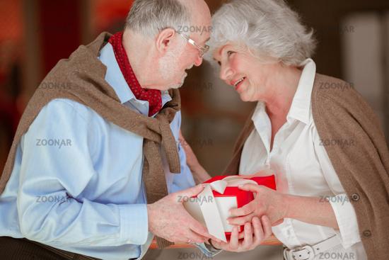 Senior Couple with Christmas Gift
