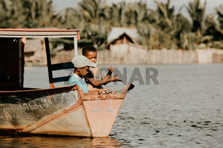 Young boys catch fish with fishing line