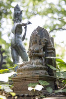 Indian gods figurines in a wonderful garden