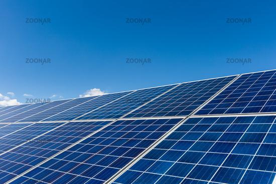 solar panels against a blue sky