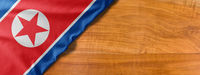 National flag of North Korea on a wooden background with copy space