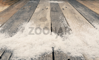 Old wooden plank with snow