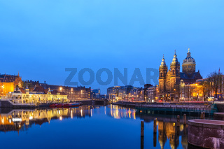 Amsterdam Netherlands, night city skyline at Basilica of Saint Nicholas