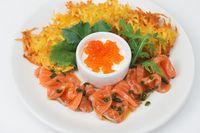 potato pancakes salmon fish and red caviar