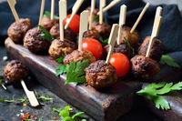 Fried meatballs on skewers
