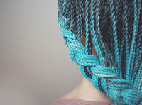 braids Senegalese braids are intertwined to the girl's hair, blue braids, hair in the African style