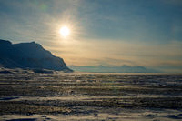 Winter sun over mountains in Billefjorden, Svalbard