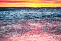 the sky is purple from the sunset, sunset on the seashore