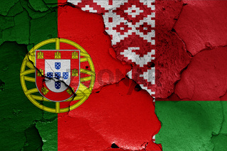 flags of Portugal and Belarus painted on cracked wall