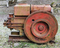 Rusty  vintage  small  tractors  diesel engine  in forgotten village.