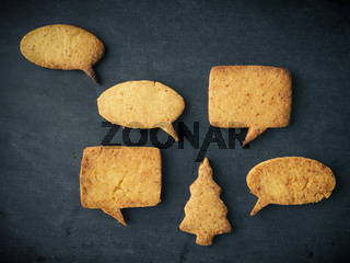 Tasty Christmas cookies on chalkboard