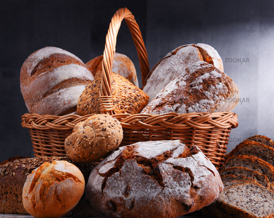 Composition with assorted bakery products in wicker basket