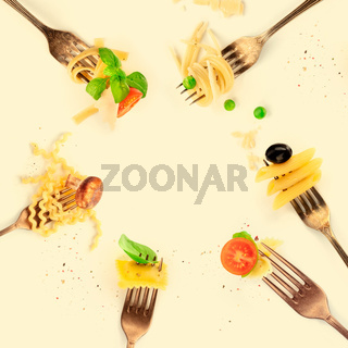 Italian food design, pasta collage. Forks with pasta and various addings, shot from the top, forming a square frame for copy space, toned image