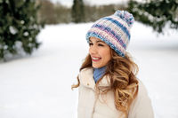 portrait of happy smiling woman outdoors in winter