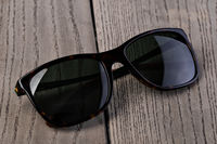 Black Sunglasses On a wooden