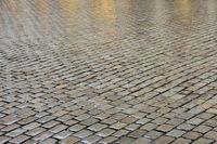 Wet cobblestones on the street