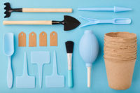 Gardening tools on blue background flat lay