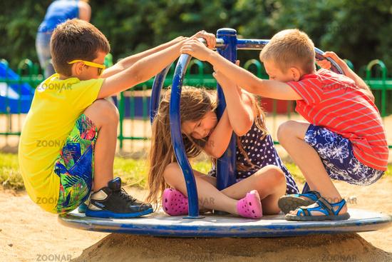 Kids having fun on playground.