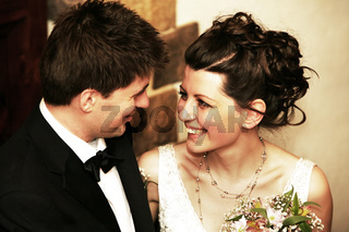 Romantic moment between bride and groom celebrating their wedding day