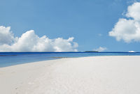 White sand and turquoise waters on the Indian Ocean beach in the Maldives