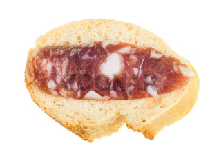 sandwich with bread and slice of cured sausage