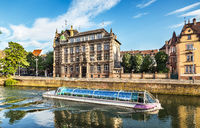 Landscape Of Strasbourg with excursion boat and beautiful houses