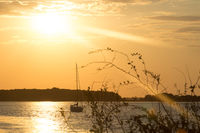 golden, romantic sunset with sailing ship in Aalborg, Denmark, Baltic Sea