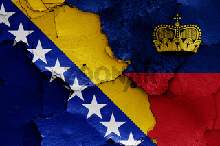 flags of Bosnia and Herzegovina and Liechtenstein painted on cracked wall