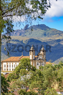 Ancient historical catholic church and mountains in the city of Ouro Preto