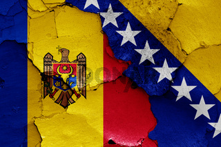 flags of Moldova and Bosnia and Herzegovina painted on cracked wall