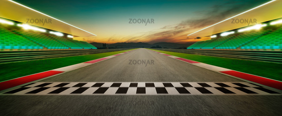 Motion blurred racetrack with start or end line . Horizontal format .Night scene .