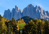 Autumn evening Santa Magdalena famous Italy Dolomites village surroundings in front of the Geisler or Odle Dolomites mountain rocks. Picturesque traveling and countryside beauty concept background.