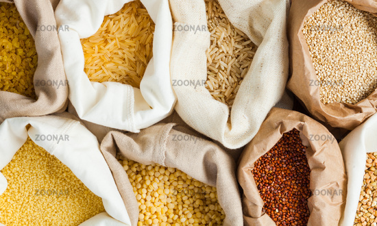 Textile bags full of cereals, close up. Healthy eating concept
